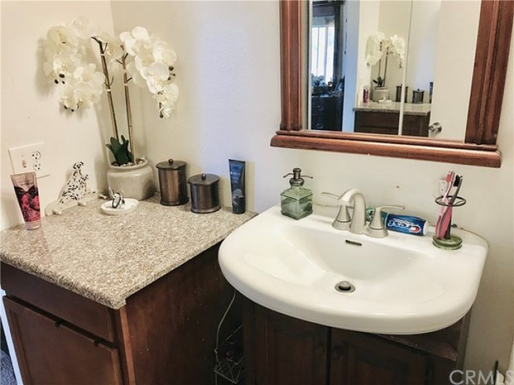 Master Bathroom with Granite Counter. This bathroom has a shower.