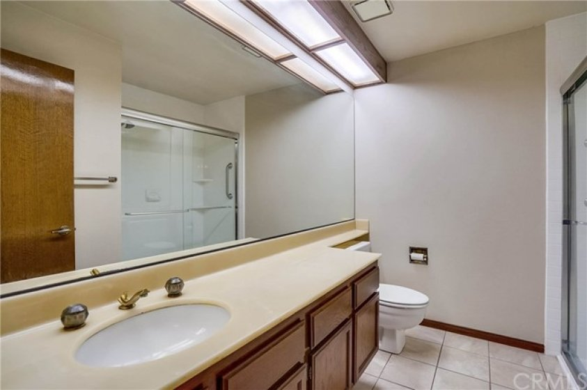 Another view of bathroom and shower.