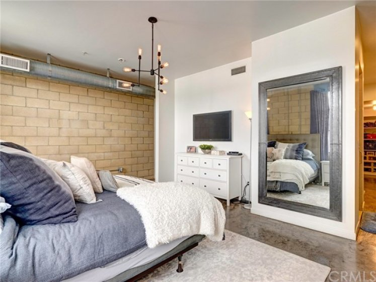 Contemporary and modern master bedroom suite with Edison light chandelier.