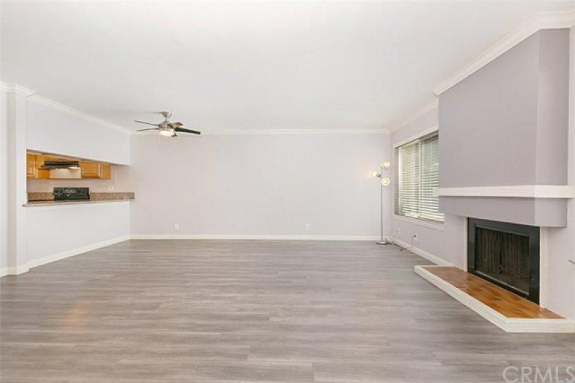 Inviting fireplace flanked by windows on each side.  Very private location!