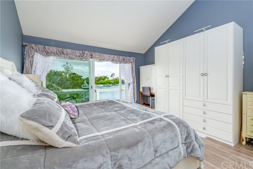Imagine waking up every morning to this most stunning view of the lake. Landmark Woodbridge gazebo can be seen from your home. Master has Walk-In Closet in the spacious bathroom and is light and bright.