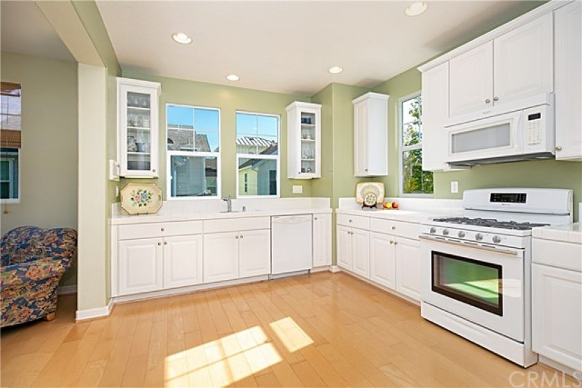 Expansive kitchen is great for entertaining with ample room for preparing foods and storage. Clean and bright with wood flooring and recessed lighting, this kitchen is great for enjoyable times with friend & family.