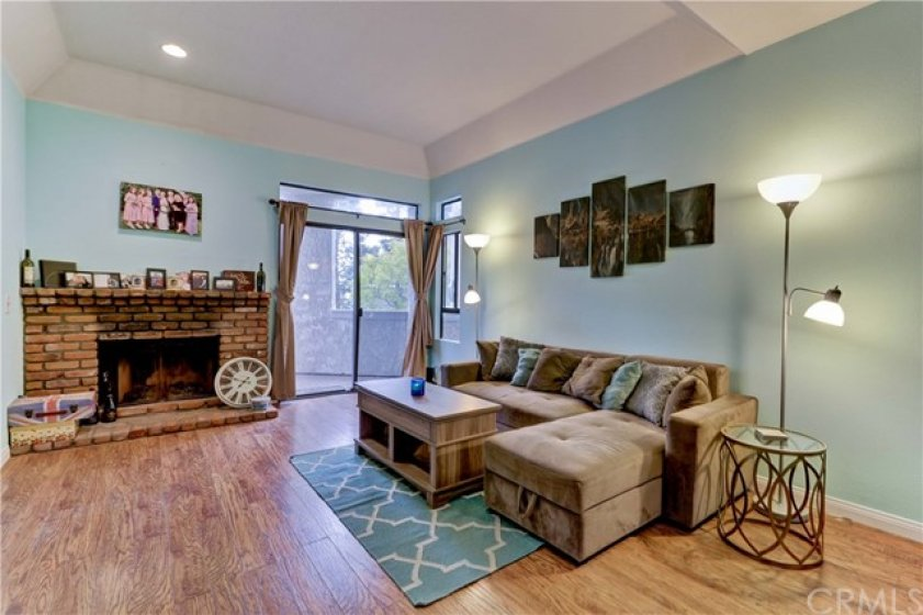 Laminate flooring throughout all living spaces. Extra high ceilings in the living room and cozy fireplace.