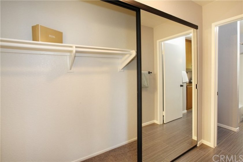 Both closets have ample room for hanging clothes and storage