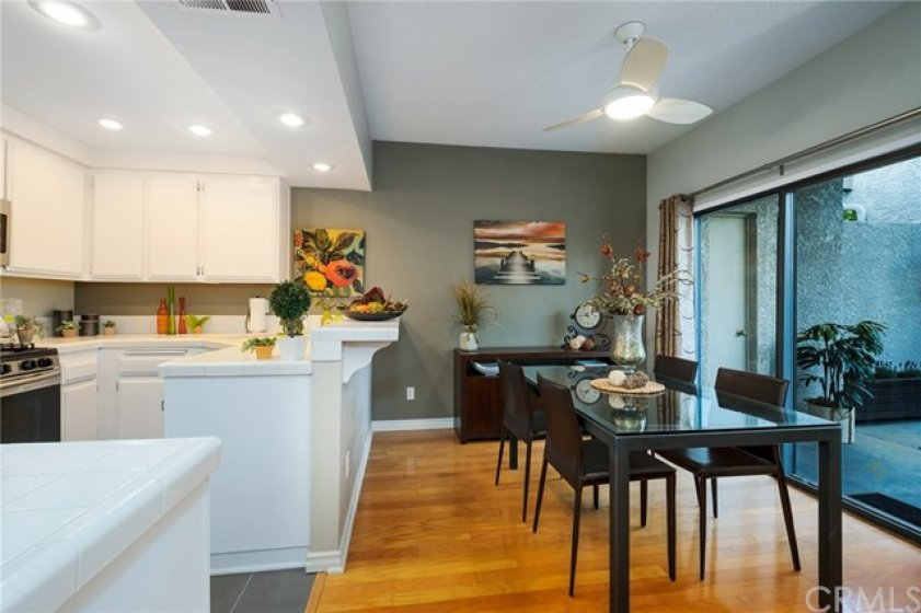 Ceiling fan and recessed lighting add to the charm and convenience