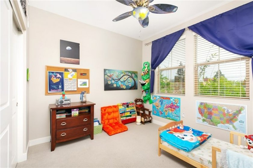 Bedroom with Large Windows and Ceiling Fan
