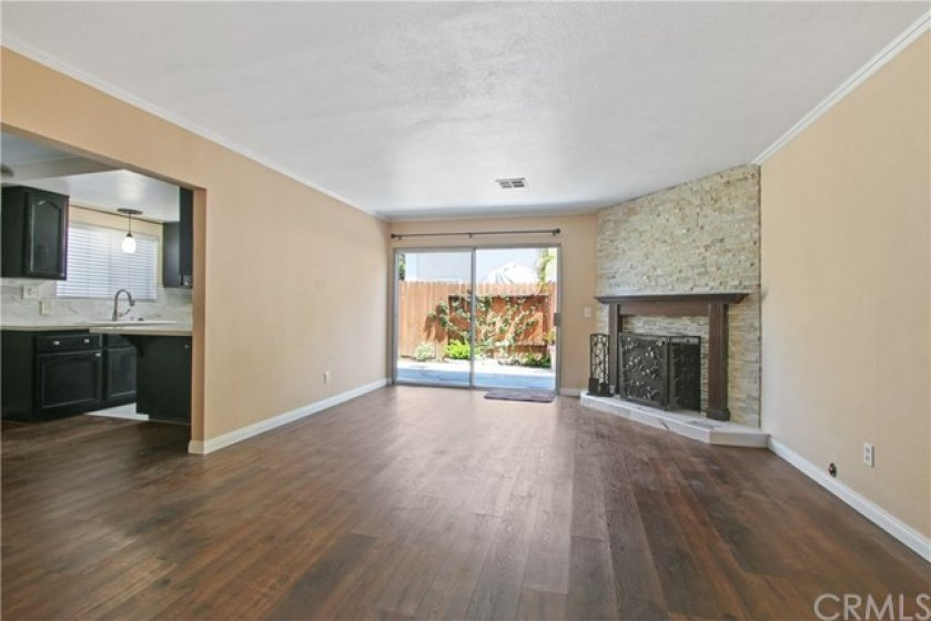 This unit has open floor plan with new wood flooring