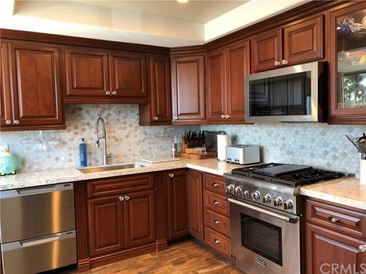 newer quartz counters, newer SS appliances including newer SS sink