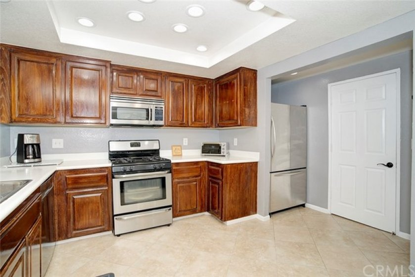 Spacious kitchen with solid surface counters, recessed lighting, tile flooring, newer 6 panel doors through out