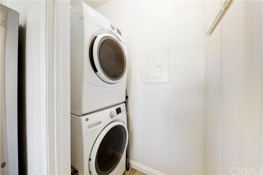 Stackable Washer and Dryer with storage cabinets.