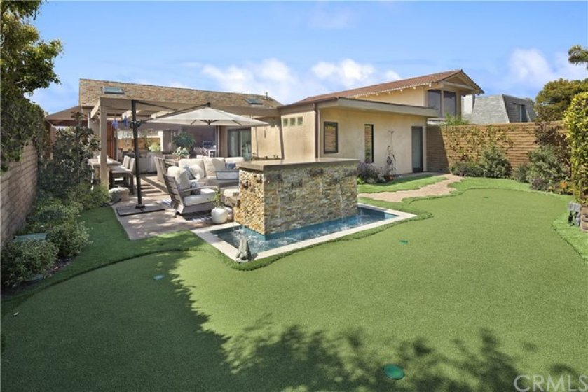 BACKYARD with 4-HOLE PUTTING GREEN, FOUNTAIN, and FIREPLACE