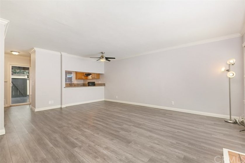 Quality laminate wood flooring throughout the downstairs, crown molding, smooth ceiling