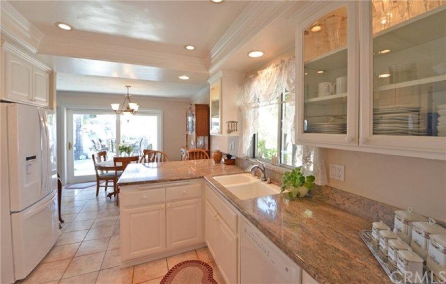View of kitchen to the right as you enter the home.