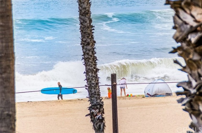 Watch the surfers, swimmers, enjoying the ocean and beach