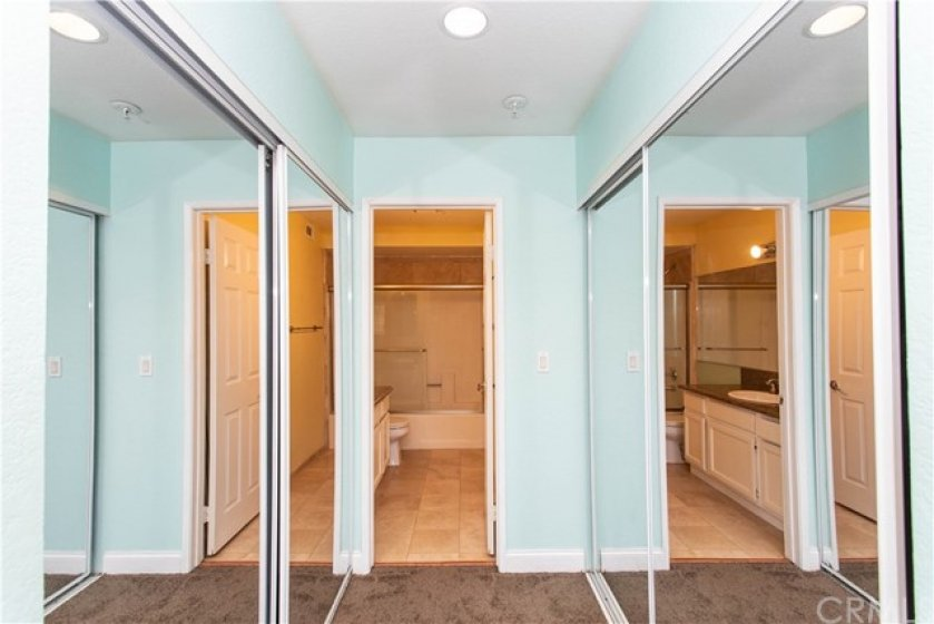 Dual mirrored wardrobes in primary suite