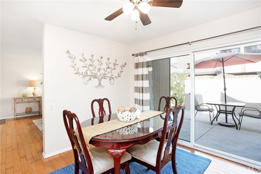 Dining room with sliding glass door to outdoor patio.