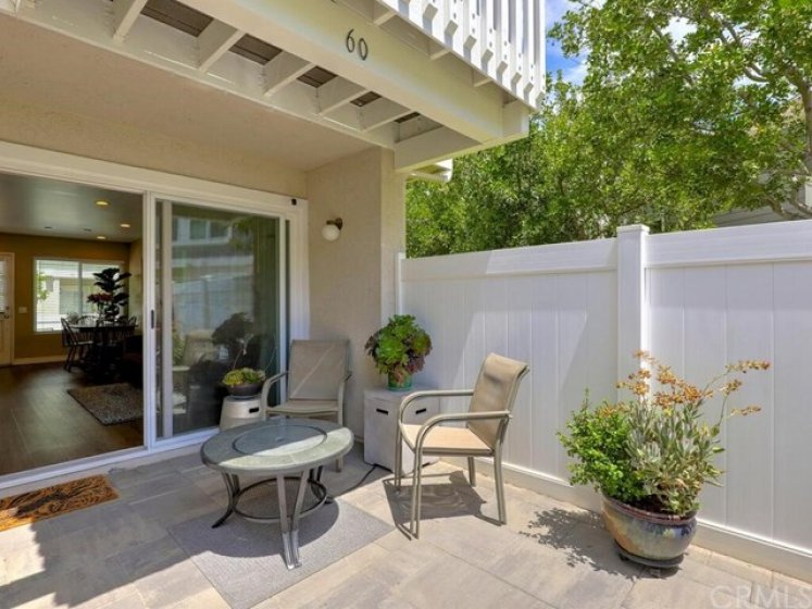 The sizeable back patio is bordered by trees and vinyl fencing and has room to relax and enjoy the Southern California sun.