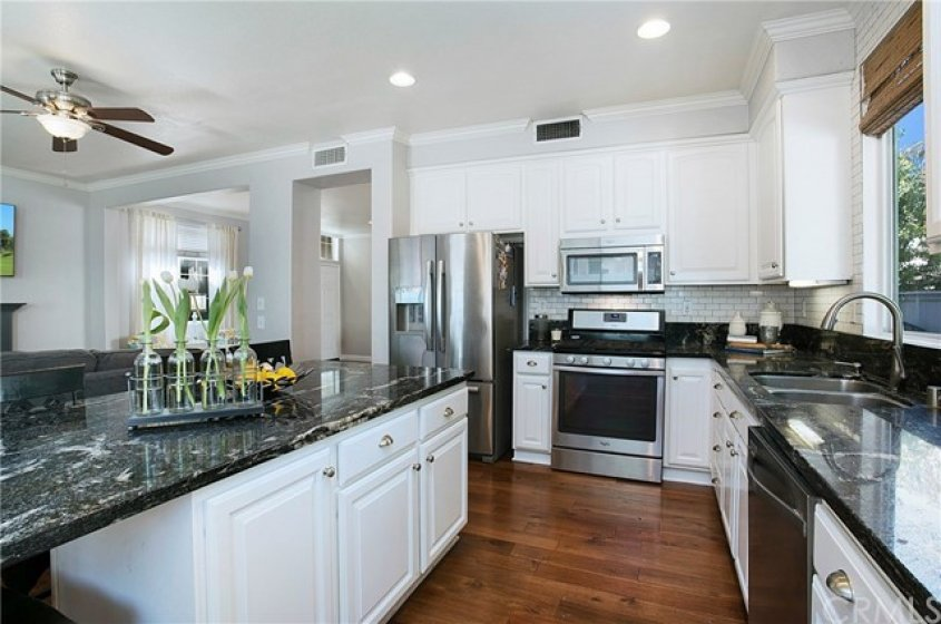 Remodeled kitchen with granite, white subway back splash and stainless appliances