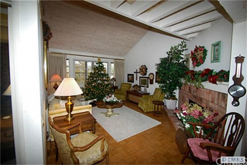 Living Room has brick fireplace and sliding doors leading to deck area with great views
