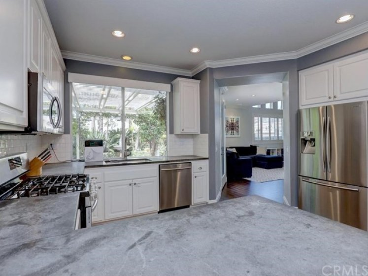 The kitchen, with its soapstone counters, opens to the backyard and other living areas.