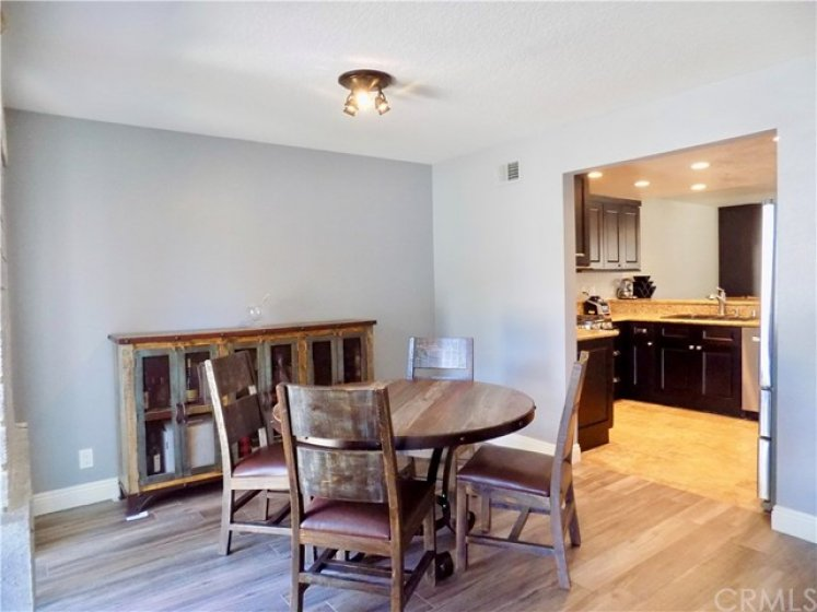 Dining area with large entry into kitchen.