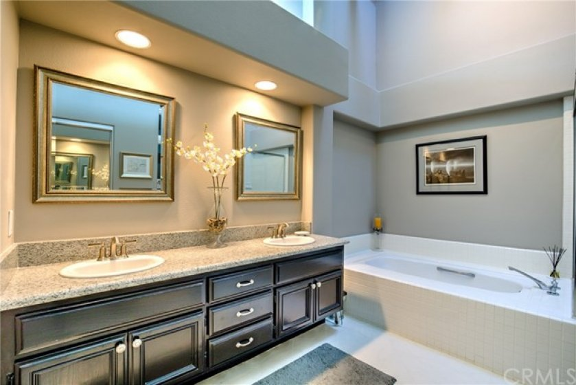 Master Bathroom with dual vanity and tub
