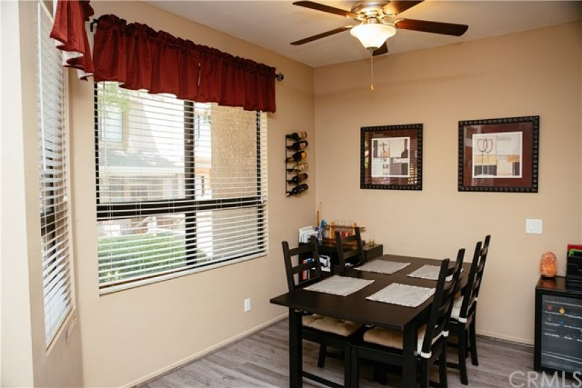 Nice sized dining room with ceiling fan, lot of natural light and vinyl plank floors.