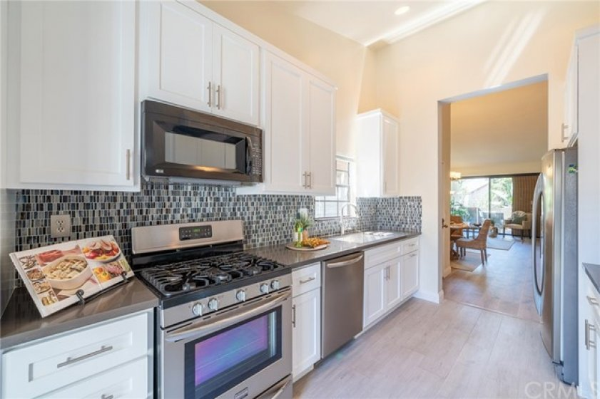Beautiful bright kitchen with ample cabinetry space and lovely design