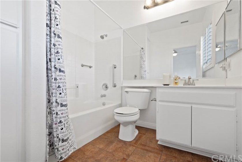 Secondary bathroom located privately inside the 2nd bedroom includes linen closet and window is convenient for light.