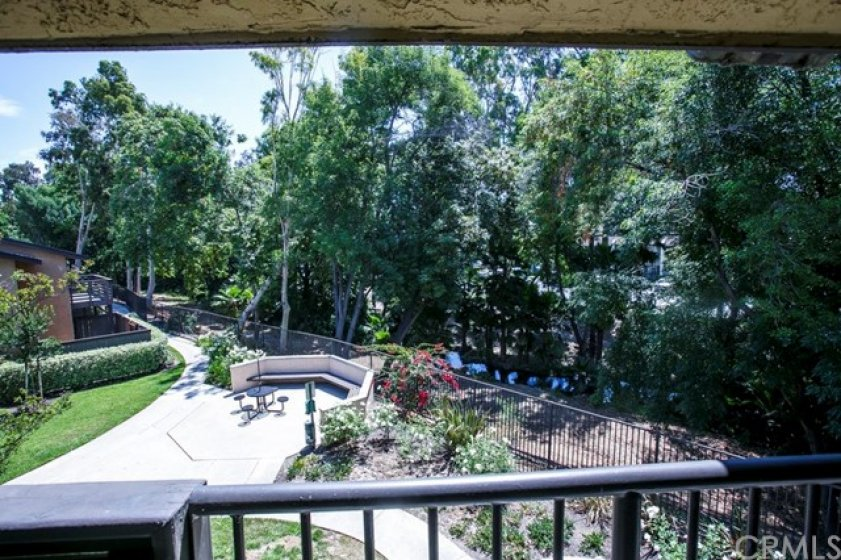 This unit is ideally located at the rear of complex by the creek. Quiet & serene.  Location, location, location.