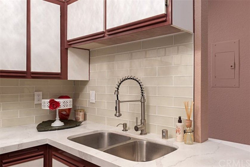 New stainless steel sink and faucet