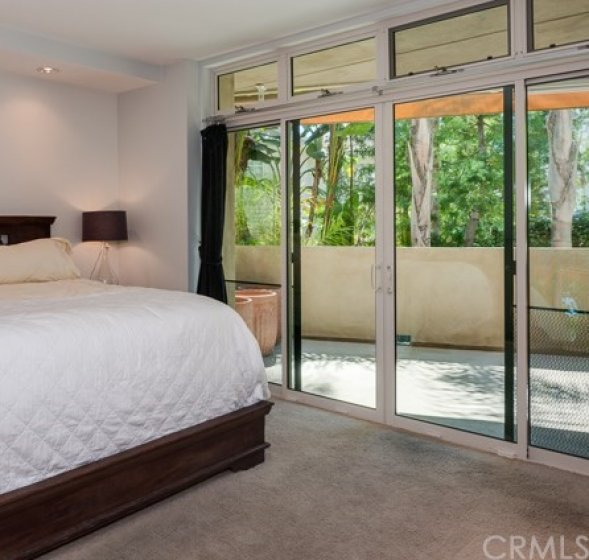 . . . Master bedroom with large deck with retractable awning . . .