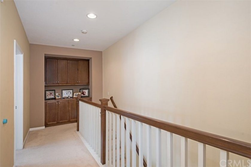 The upstairs hallway offers spacious linen storage