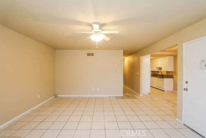LivingroomLookingTowardHallway_Kitchen_DiningArea