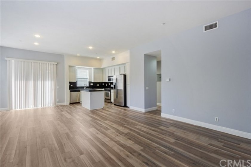 Upstairs, you'll find a great room with open floorplan & balcony by the dining area
