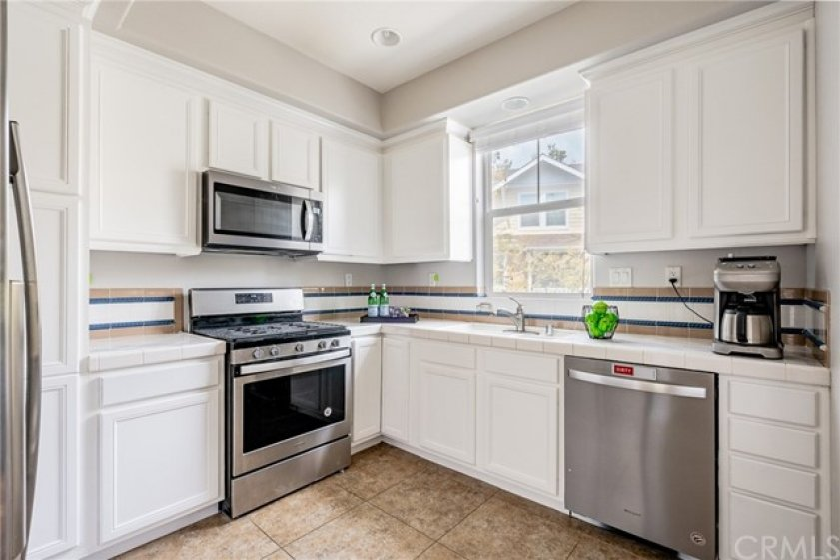 white on white kitchen with plenty of storage.