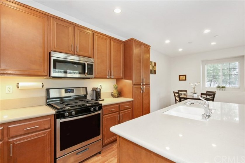 Brand new stainless steel range & plenty of cabinet space in the open kitchen