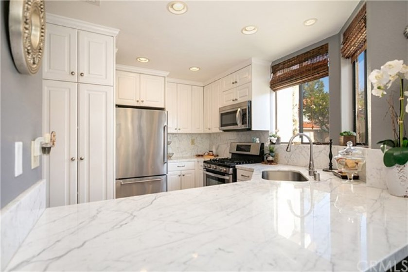 Kitchen is light & bright. Marble counter tops, stainless steel appliances, and large breakfast bar accompany this great entertaining space.