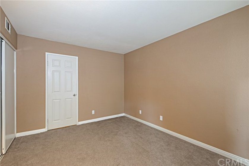 Large main floor bedroom with attached bathroom