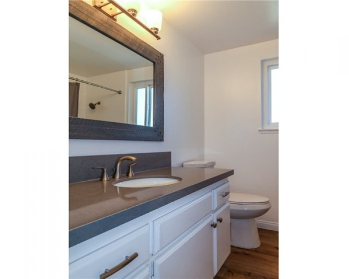 UPDATED FULL BATHROOM WITH TUB/SHOWER COMBO.