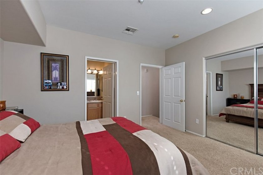Master bedroom.  Mirrored closet doors.