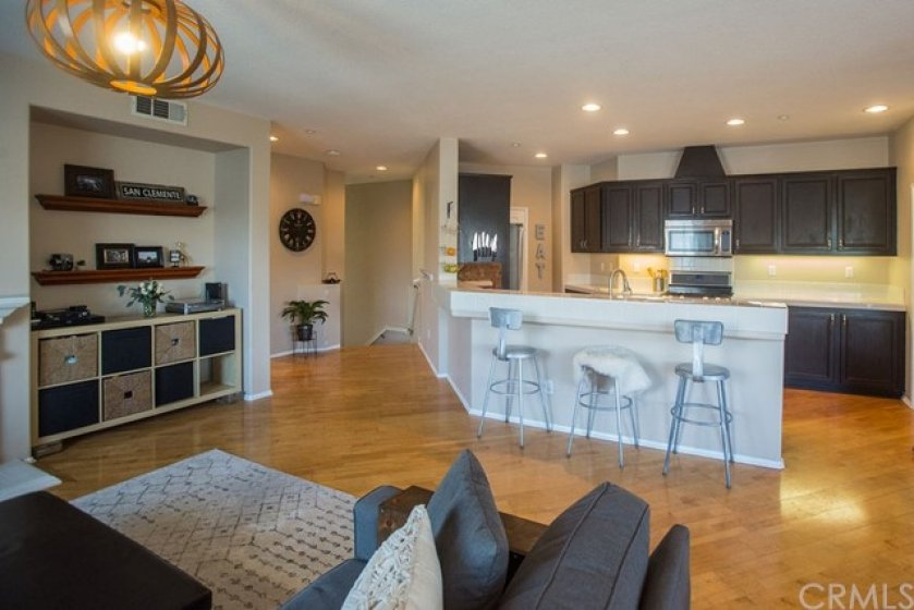 The living room is open to the large kitchen, which features a breakfast bar.