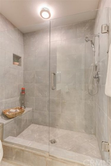 Relax after a long day (or start your day right!) in this walk-in master bathroom shower
