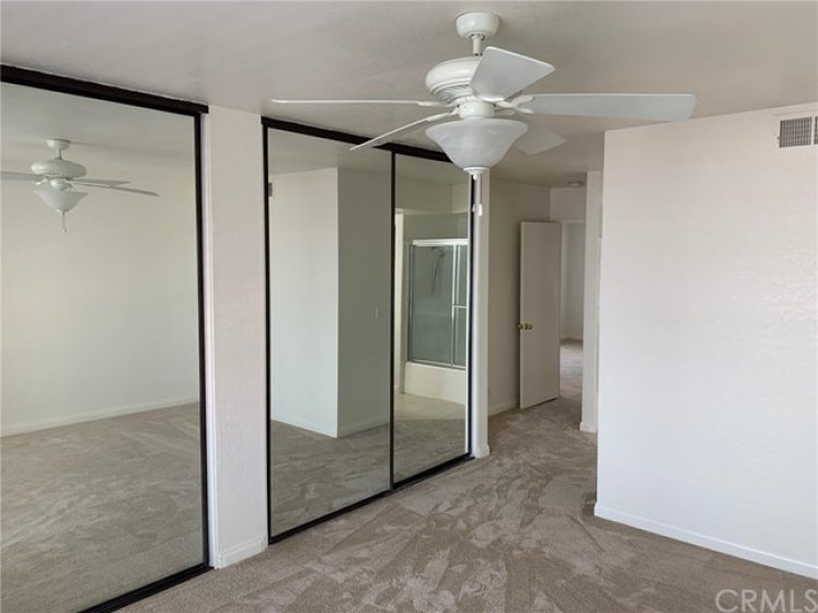 Master Bedroom with Mirrored Closets