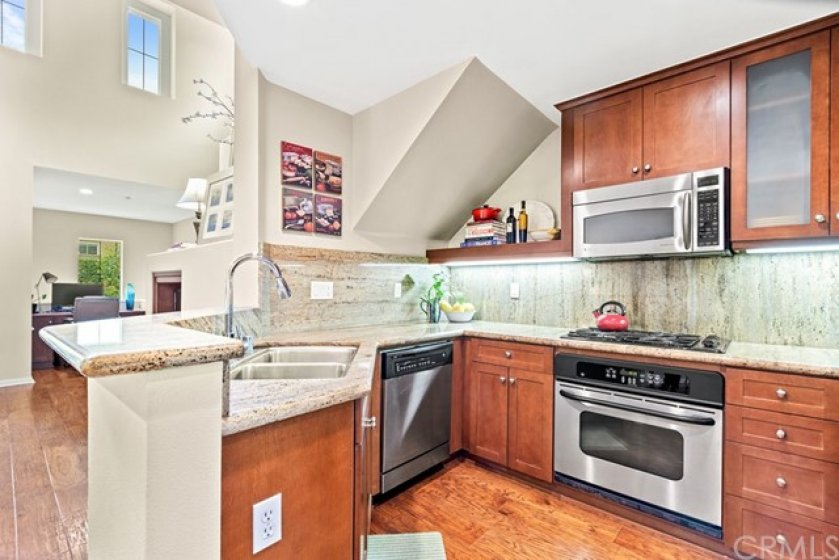 Beautiful kitchen with granite counter tops, stainless steel appliances and plenty of cabinets for storage!