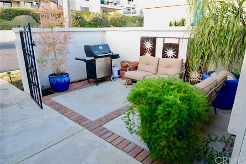Enjoy the Privacy and Convenience of the front courtyard. Perfect for entertaining.