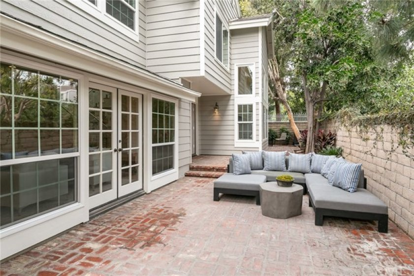 Large patio w multiple areas, French Door Entry, Privacy and great Light from this corner unit