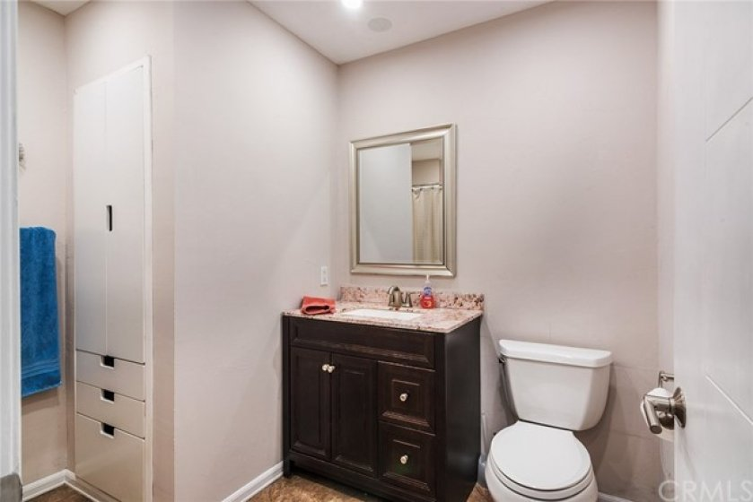 Bathroom is updated with newer vanity and mirror.  There is also plenty of storage.