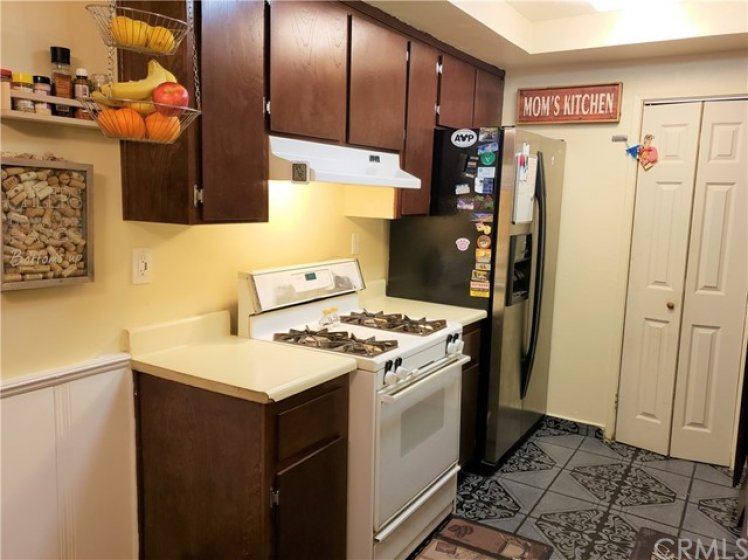Kitchen - Left Side View.  Note: Pantry at Far Side.