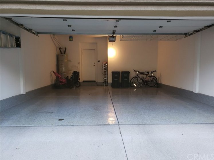 Here's your epoxied floor 2-car, attached with direct access garage with overhead storage, roll-up door.  Convenient hot water heater out here.  Finished walls make it so clean and part of the home itself.  WELCOME HOME!